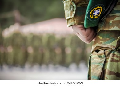 officer's hand holding beret during oath in Greek army