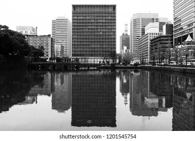 Offices reflecting in the water near the Imperial Palace, Toyko