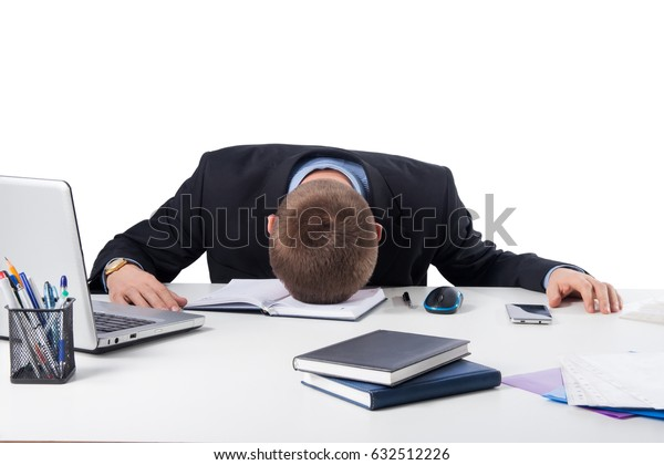 Office,technology, finances, internet, business, success and people concept-Exhausted businessman falling asleep at his office desk isolated on white