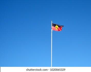 Official Aboriginal flag waving in sun light in victoria, australia