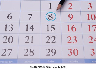 the official calendar printed by the printer with the eighth date circled