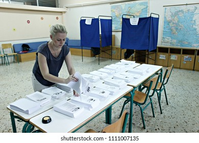 Official checks the ballot papers in polling station during the Greek legislative election at a polling station in Thessaloniki, Greece on Sep. 20, 2015
