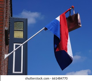Official Dutch flag with a satchel, a tradition when a student graduates
