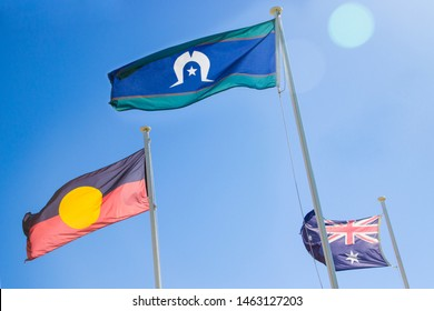 Official flags of Australia: the Australian flag, Aboriginal flag and Torres Strait Islander flag