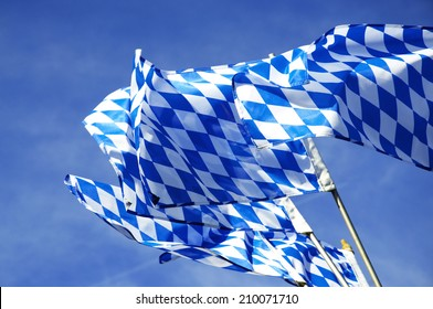 The official Flags of Bavaria waving over the Oktoberfest in Munich.