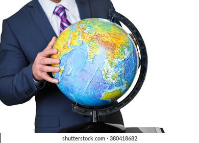 An official holds a globe. Touching the planet. The hand of scholar. Give the world a spin.