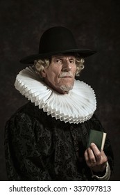 Official portrait of historical governor from the golden age. Holding a book. Studio shot against dark wall.