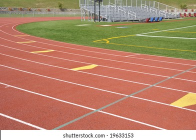 Official red running track lanes at high school