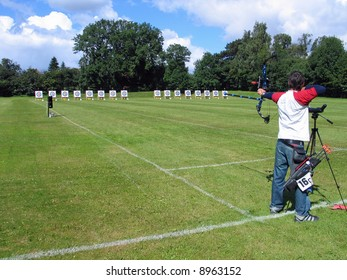 An official target shooting - an archer aim and shoots