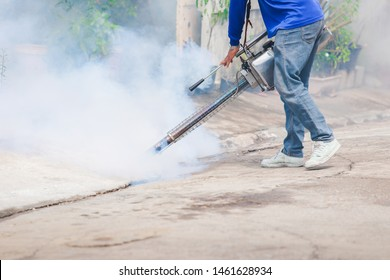 Officials are spraying mosquito repellent in the area of house to prevent dengue mosquitoes as carriers of dengue fever.