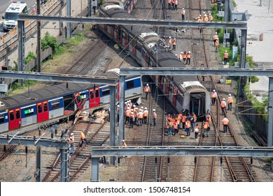 Officials stand around an MTR Corp. derailed train near Hung Hom station in Hong Kong, China, on Tuesday, Sept. 17, 2019.