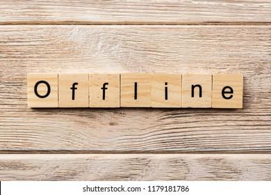 offline word written on wood block. offline text on table, concept.