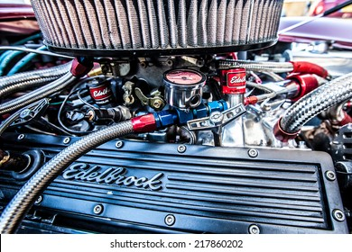 OFFORD DARCY, CAMBRIDGESHIRE, UK - 08 JUNE 2014:  A V8 Sports car receives final tuning prior to customer delivery after a rebuild by a custom motor tuners on JUNE 08 2014 in Offord Darcy.
