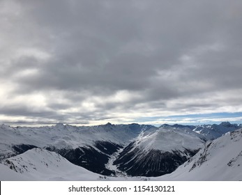 Offpiste views of mountains and skiiers in Klosters, Switzerland near Davos