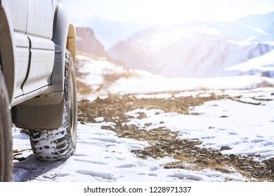 Offroad 4x4 car wheel on snow surface. Winter tires concept
