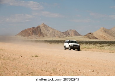 A off-road car in a namibian dirt road