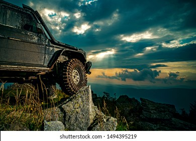 Offroad car on mountain road. Shock absorber for off road car. Car brakes with absorbers. Car tire. Tire for offroad