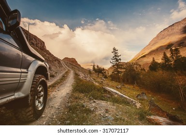 Off-road car on mountain road