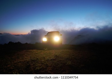 off-road car over the clouds at the twilight on the mountain of Nebrodi Park, Sicily