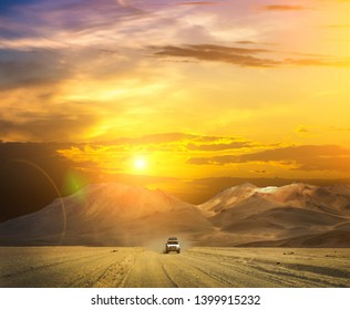Off-road car riding through incredibly beatiful sunny desert in sunrise time in Bolivia