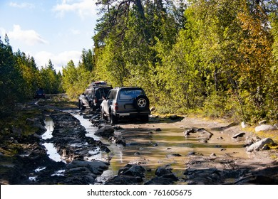Off-road extreme  travel adventure.Offroad expedition, adventure, drive by car class off-road car on forest roads. Travel in Summer vacation