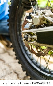 Off-road motorbike rear wheel close-up.