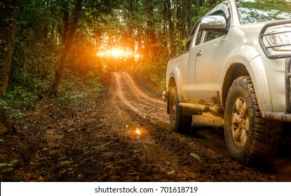 Off-road travel on mountain road. Beautiful nature sunset