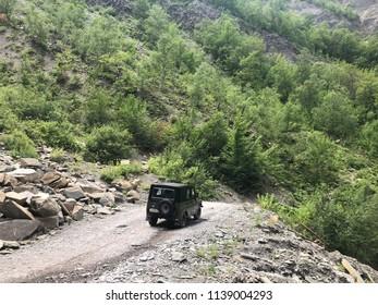 Off-roader car in the rural road