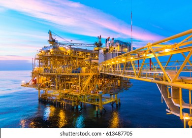 Offshore construction platform for production oil and gas with bridge in evening time