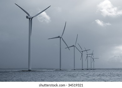 Offshore Danish wind farm form Jutland, Denmark. Roenland Wind Park. Blue toned.