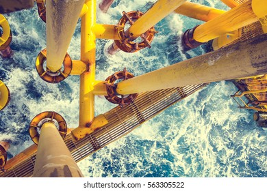Offshore drill yellow and gas production petroleum pipeline waves sea.