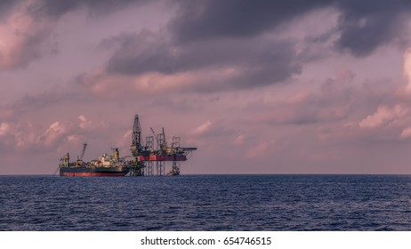 Offshore drilling oil and gas platform with FPSO facility and jack up drilling rig in offshore field