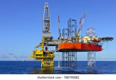 Offshore Drilling Rig on oil well platform with blue sky background offshore oil field
