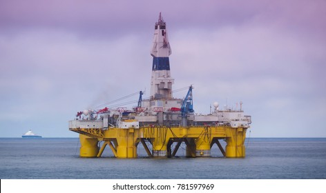 offshore drilling rig or platform in Gulf of Mexico, petroleum industry, with vessel in background