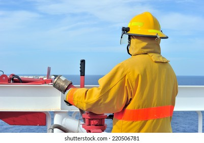 The offshore fireguard standing by on the helideck