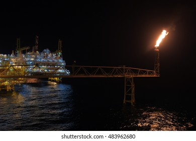 Offshore flare bridge night twilight, process released pressure to flare, Construction engineering designed, Petroleum industry and business, Night light electricity