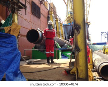 Offshore gas pipe lifting perform by rigger team on the pipelay barge at South China Sea.