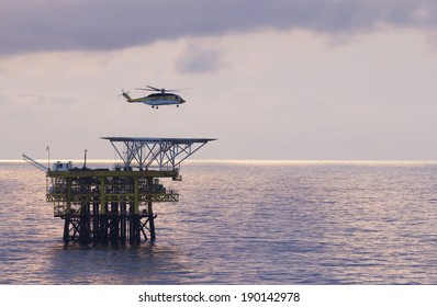 An offshore helicopter transporting roughnecks to oil-rigs