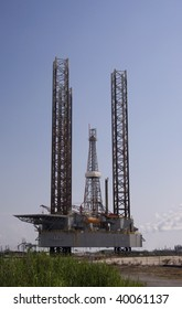 Offshore Jack up rig in port for service.