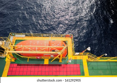 Offshore life boat station at an oil and gas platform in the Gulf of Thailand
