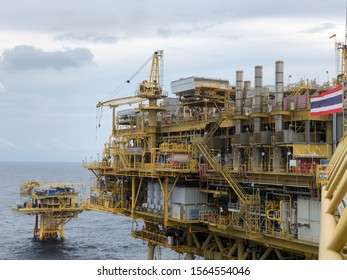offshore living quarter or a production platform for oil and gas industry in the middle of the gulf of thailand, platong gas field with gangway and radar