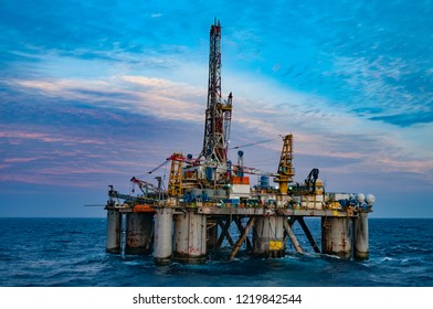 Offshore oil drilling rig at sunset, sunrise time. Rio de Janeiro, Campos Basin, Brazil.