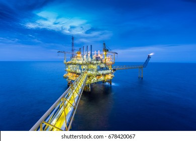 Offshore oil and gas central processing platform in sunset where produced raw gases and crude for set to onshore refinery and petrochemical plant, Power and energy business.
