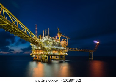 Offshore oil and gas construction platform in sun set which treat raw gas and condensate before sent to onshore refinery and petrochemical plant, Power and energy business.