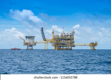 Offshore oil and gas construction platform in operation produce raw product for sent to onshore refinery and petroleum industry.