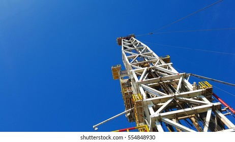 Offshore oil and gas drilling rig Derrick mass structure with clear blue sky. Metal structure