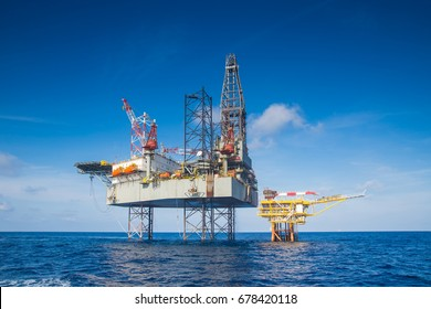 Offshore oil and gas drilling rig in the gulf of Thailand while completion gas and crude oil reservoir at wellhead remote platform.