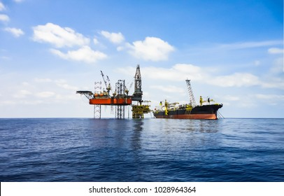 Offshore oil and gas industry facility with drilling rig, oil platform and FPSO