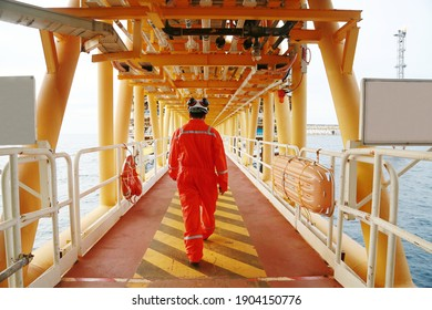 Offshore oil and gas industry and operated by technician petroleum. Worker walking to oil and gas plant for work as routine plan. Maintenance and Operation work scope in oil and gas plant.