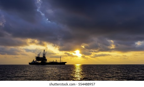 Offshore oil and gas platform evening